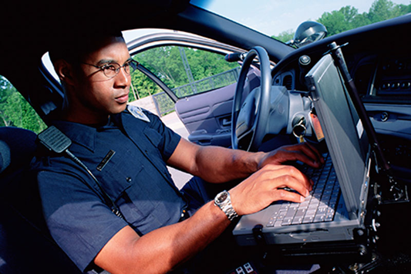 Police officer working on a computer
