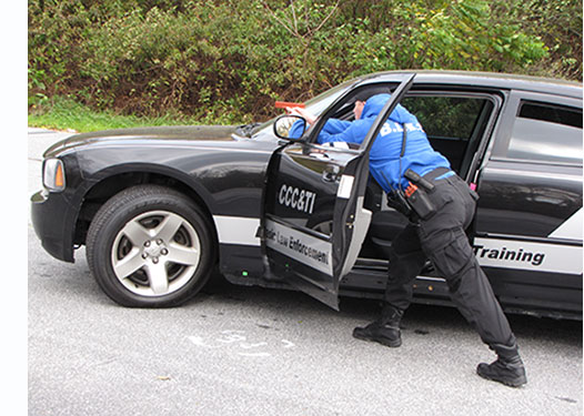 BLET students using a patrol car as a sheild
