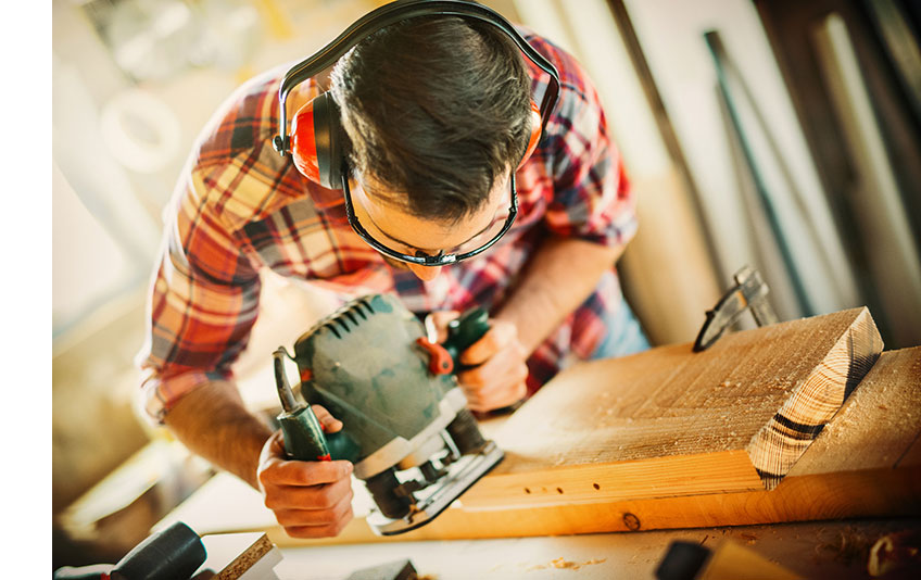 Man routing a board