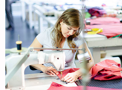 Woman using an industrial sewing machine