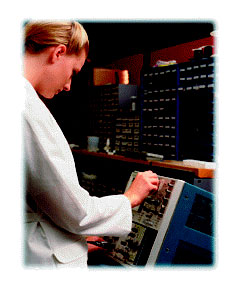 Technician working on electonic equipment