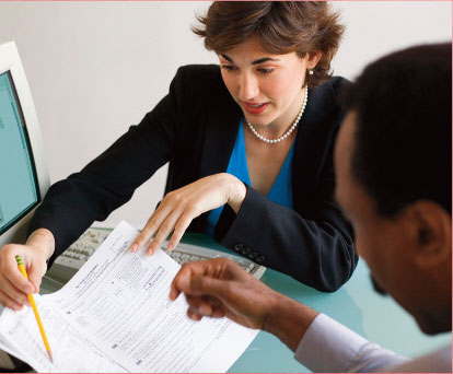 Accountant explaining a form to a client
