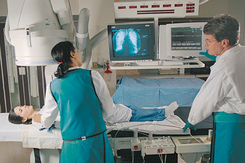 Technicians take an image of a patient