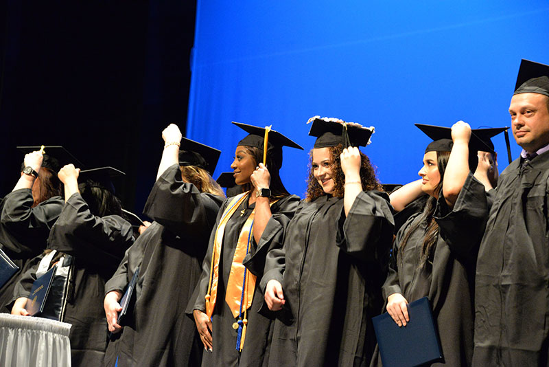 Graduates of Caldwell Community College and Technical Institute turn their tassels at the closing of the 2019 