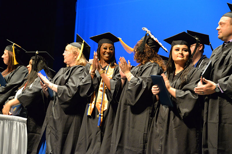 Caldwell Community College and Technical Institute graduates celebrate during Friday's ceremony.