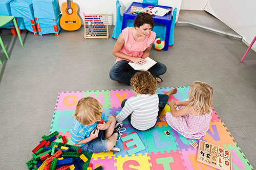 Daycare teacher with a group of children